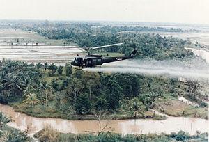 U.S. Huey-helicopter spraying Agent Orange in Vietnam